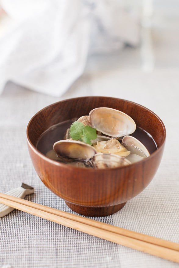 Suimono Japanese clear soup with manila clams served in a small wooden bowl