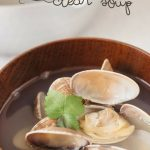 Japanese clear soup with manila clam is served in a Japanese soup bowl