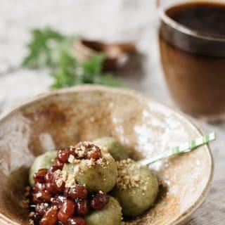 yomogi dango served in a small Japanese pottery bowl topped with sweet azuki bean paste and kinako soy bean powder