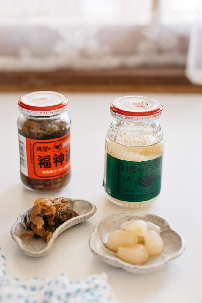 Two condiments jars, one is Fukushinduke and another is rakkyo