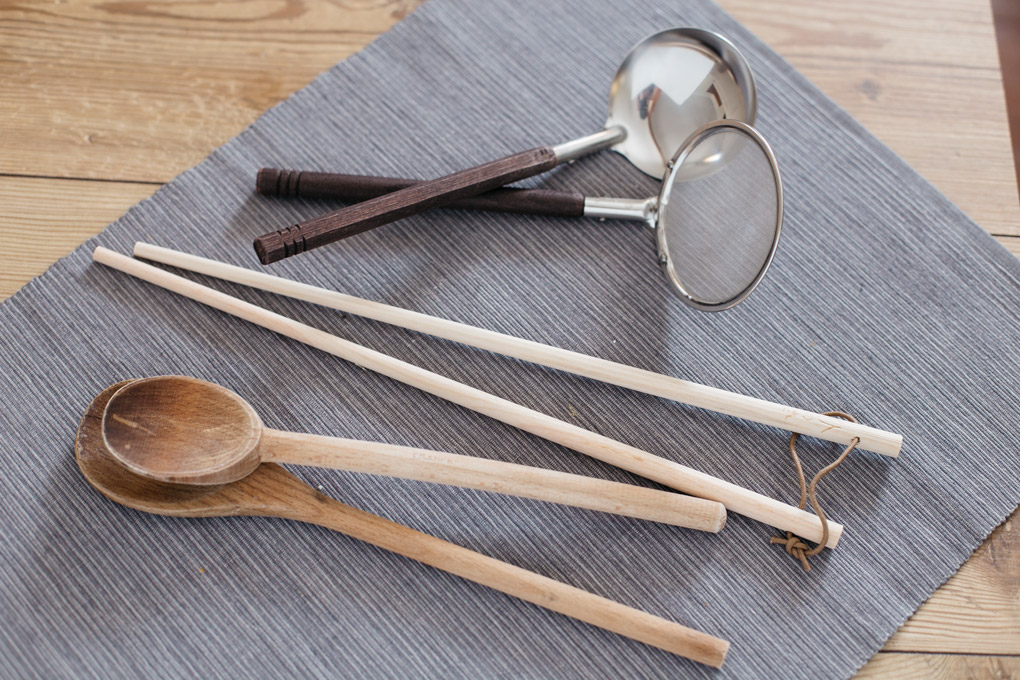 Japanese kitchen wares - a pair of chopsticks, two wooden spatulas, a scum remover and a ladle.