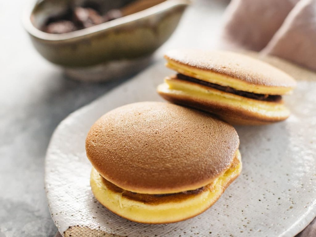 two dorayaki Japanese sweets served on an oval plate