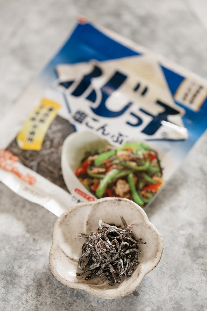 a packet of salted kelp strips and it is served on a small dish