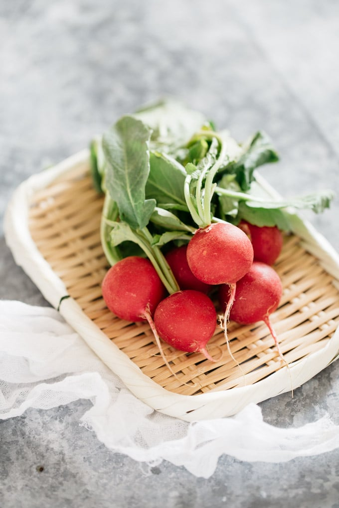 bunch of radish on a bamboo tray