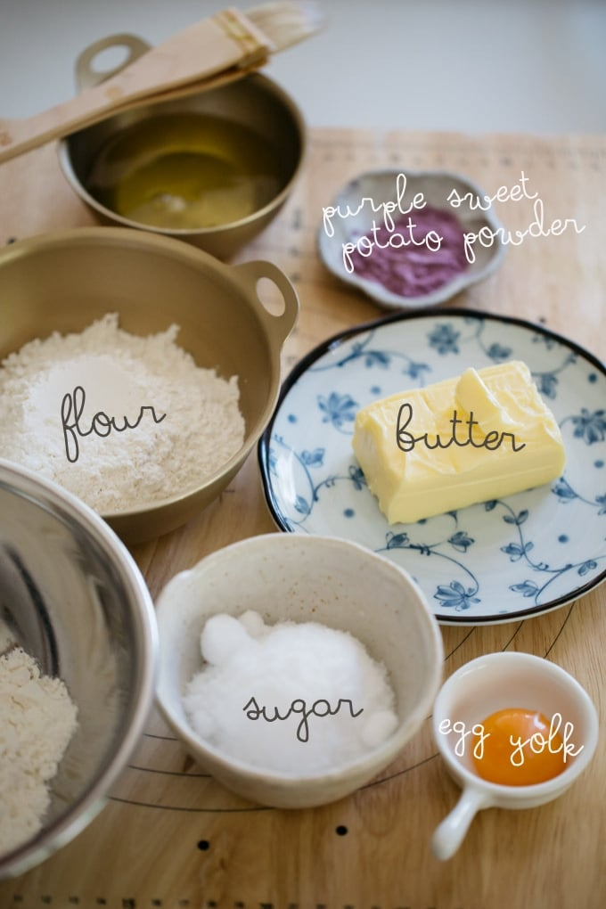butter, egg yolk, flour, purple sweet potato flour, sugar are on the kitchen bench