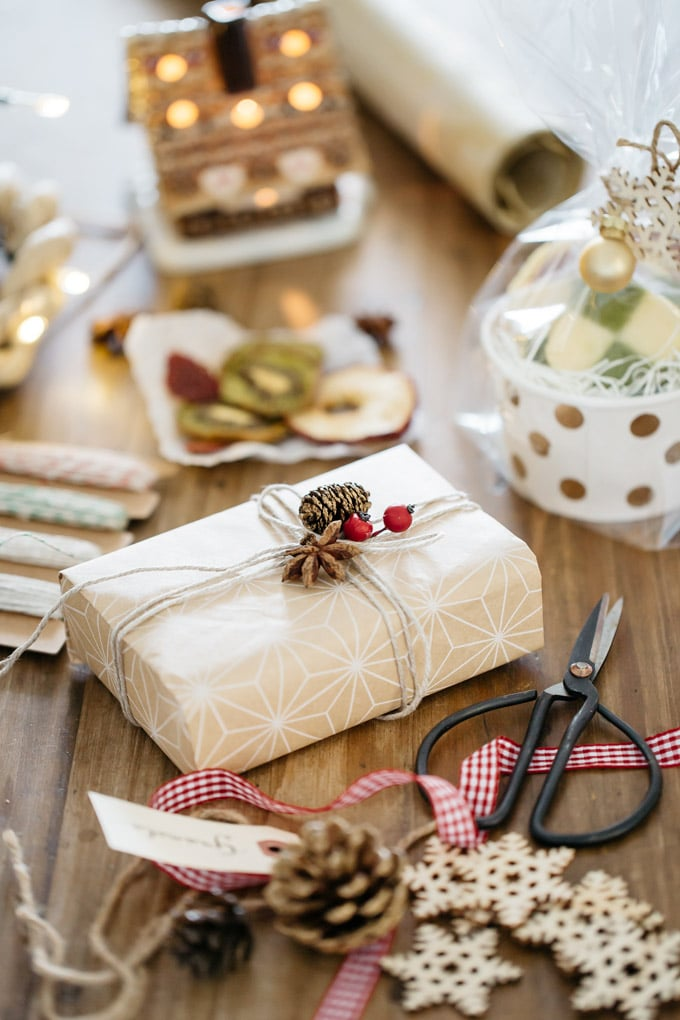 a gift wrapped up in the centre and equipments and wrapping materials sound it.