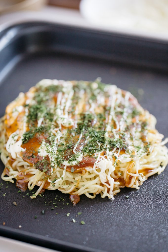 Hiroshima okonomiyaki being cooked on a hot plate