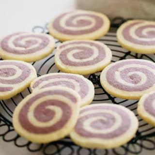Pinwheel cookies freshly baked out of the oven and cooling down on a wire rack.
