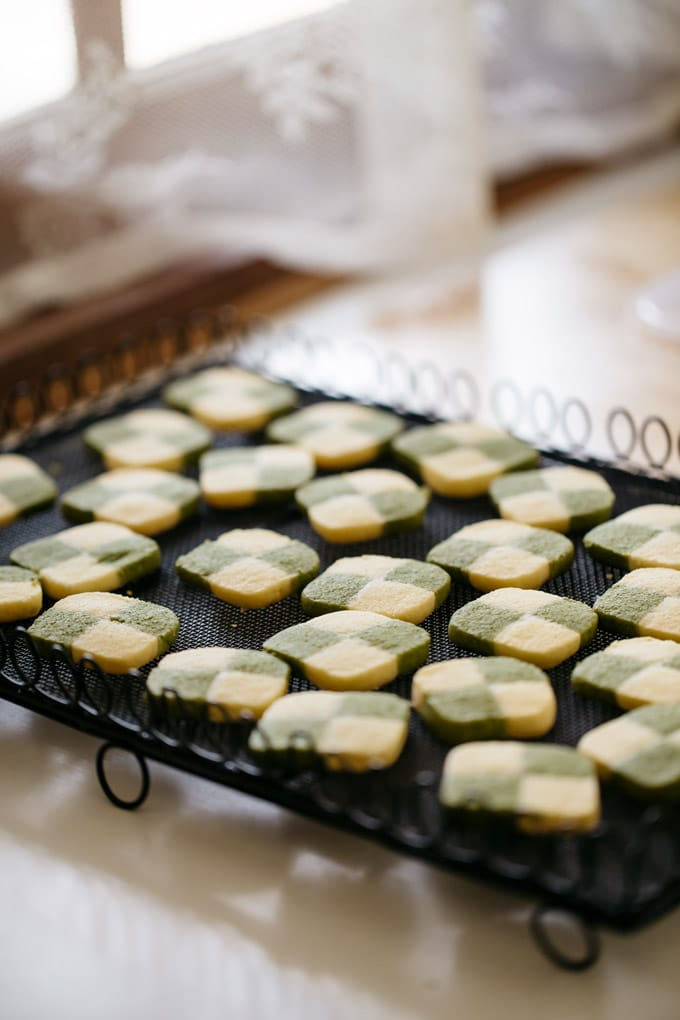 Matcha cookies freshly baked and cooling down on a wire lack