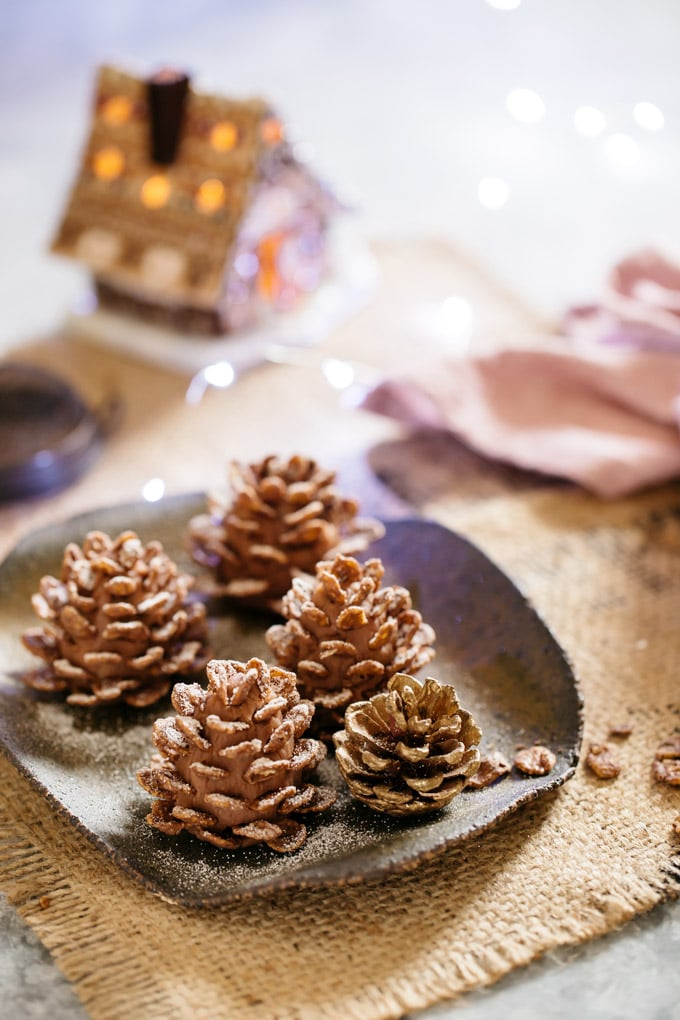 4 Edible pine cones on the square plate with Christmas lights bokeh in back ground