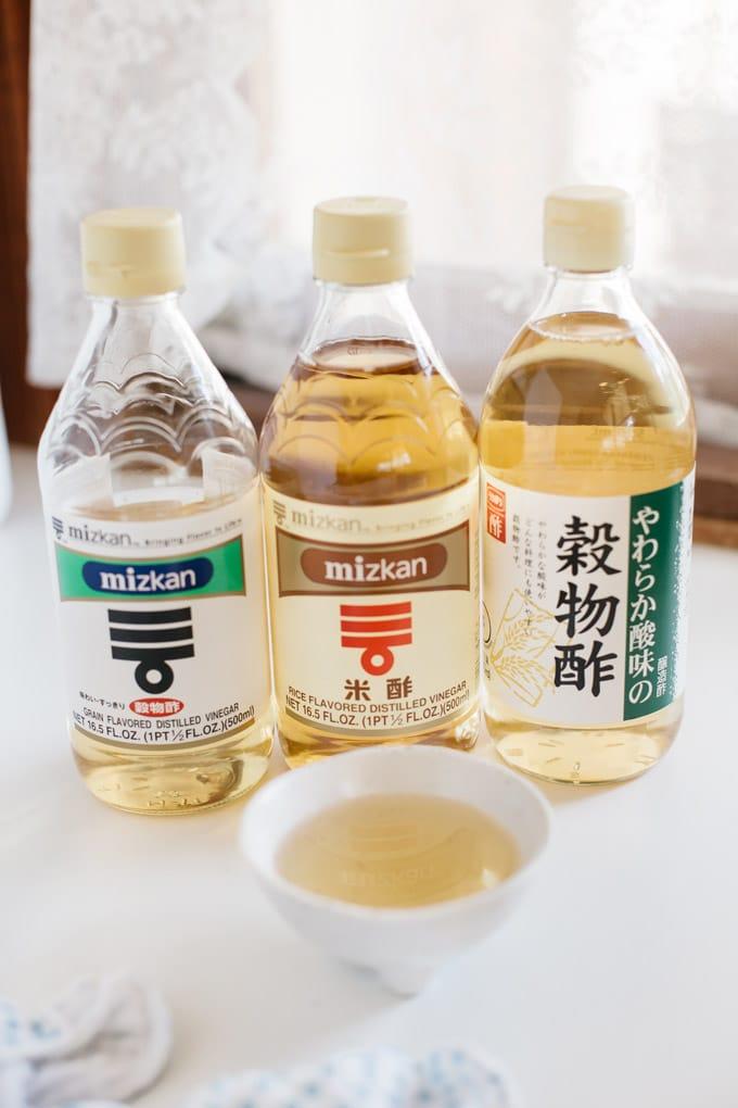 three bottles of different types of vinegar