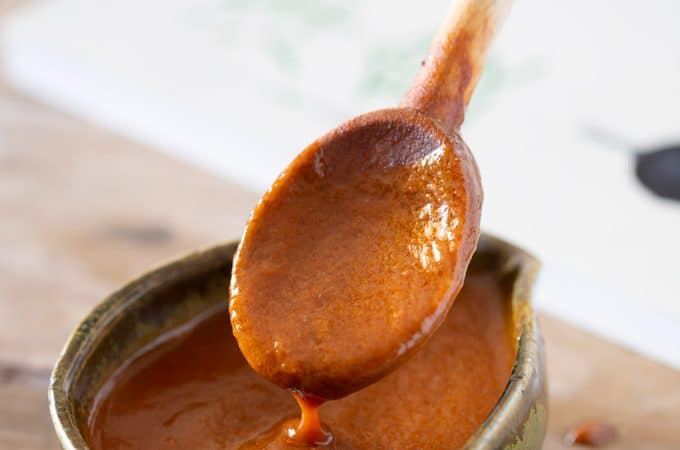 Demi glace sauce poured into a sauce bowl