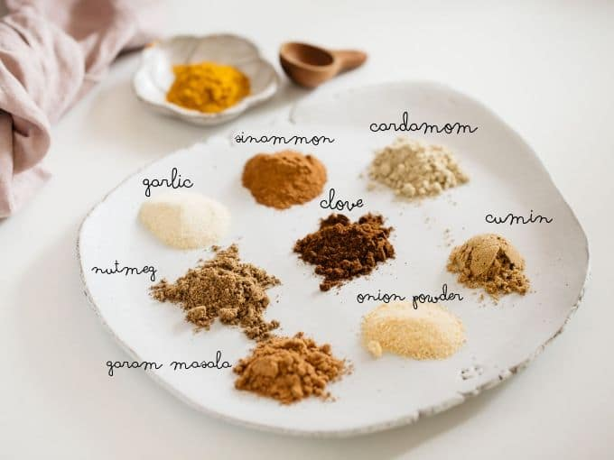 8 spices for recipe on a white plate