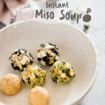 six instant miso soup bombs on a round plate