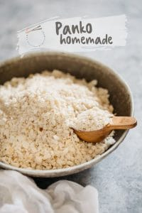 a large bowl of homemade panko crumbs with a little wooden spoon