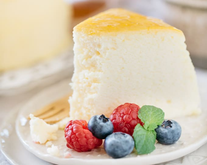 a piece of Japanese souffle cheesecake served with berries