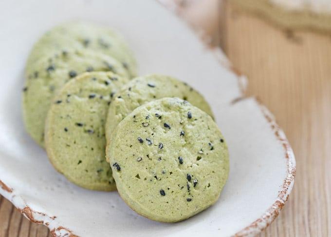 black sesame matcha cookies on an oval plate