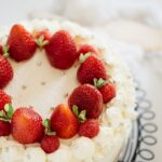 a whole strawberry shortcake cake on cooling wire