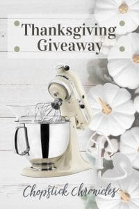 White artisan kitchenaid stand mixer with thanksgiving background and Thanksgiving giveaway text overlay