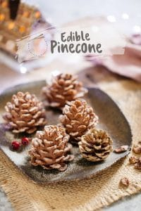 4 edible pinecone and 1 real pinecone on a plate
