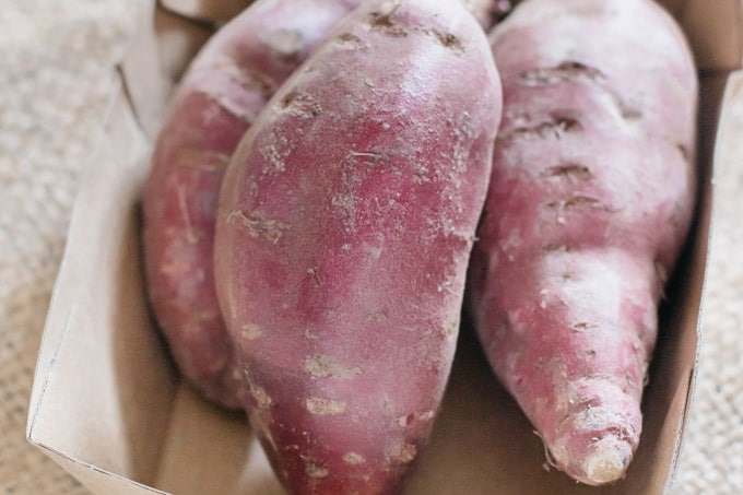 three purple sweet potatoes