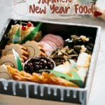 "Japanese new years food ""Osechi ryori"" dishes served in a square Japanese pottery."