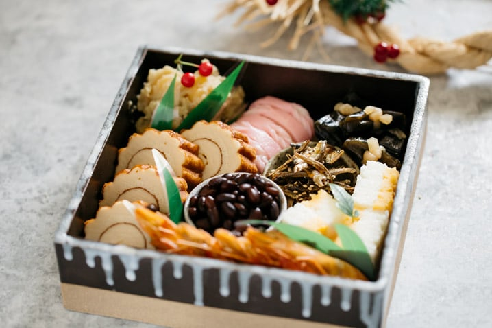 Osechi ryori dishes served in a square pottery container