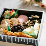 Osechi ryori served in a square Japanese pottery