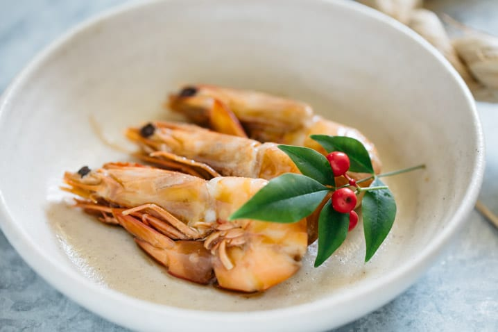 3 Simmered shrimp ebi umani are served on a shallow round bowl