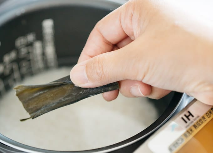 cooking rice in a rice cooker with a strip of Konbu kelp