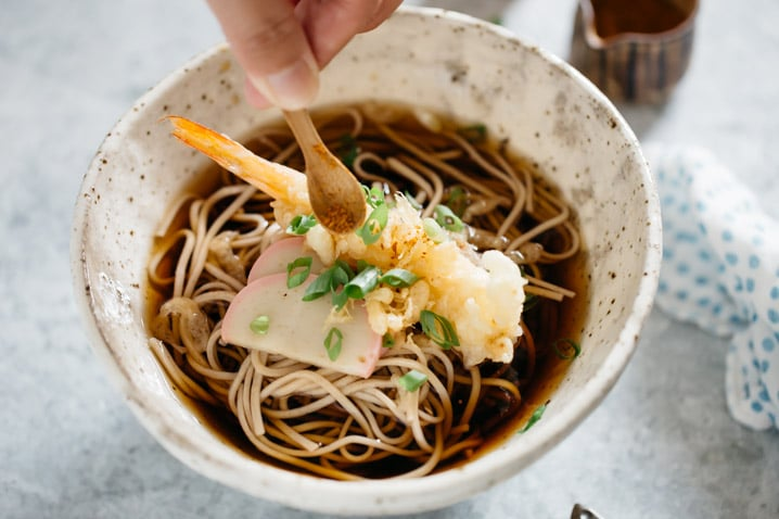 toshikoshi soba served in a noodle bowl and shichimi chilli powder sprinkled