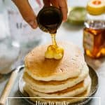 A tier of hotcakes and syrup pouring over butter on Japanese hot cakes