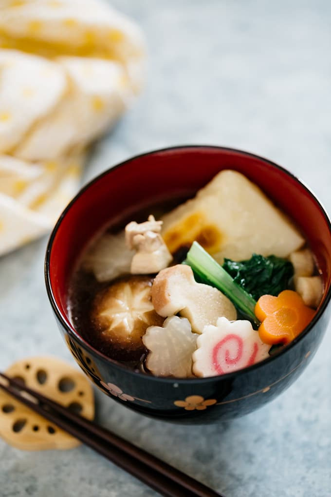 Ozoni mochi soup Kanto style is served in a Japanese lacquered soup bowl