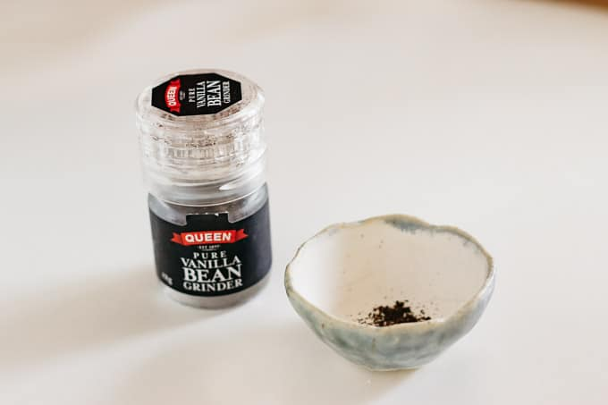 ground vanilla in a small bottle and ground vanilla in a small bowl