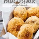 5 freshly made Japanese potato croquettes on takeaway cardboard serving dish