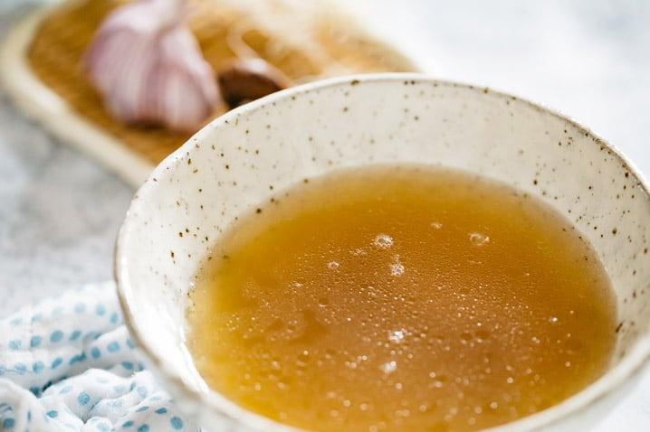 ramen broth in a ramen bowl