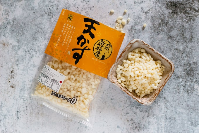 tenkasu packet on the left and tenkasu in a small bowl