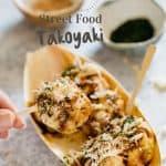Takoyaki served on a bamboo take away tray
