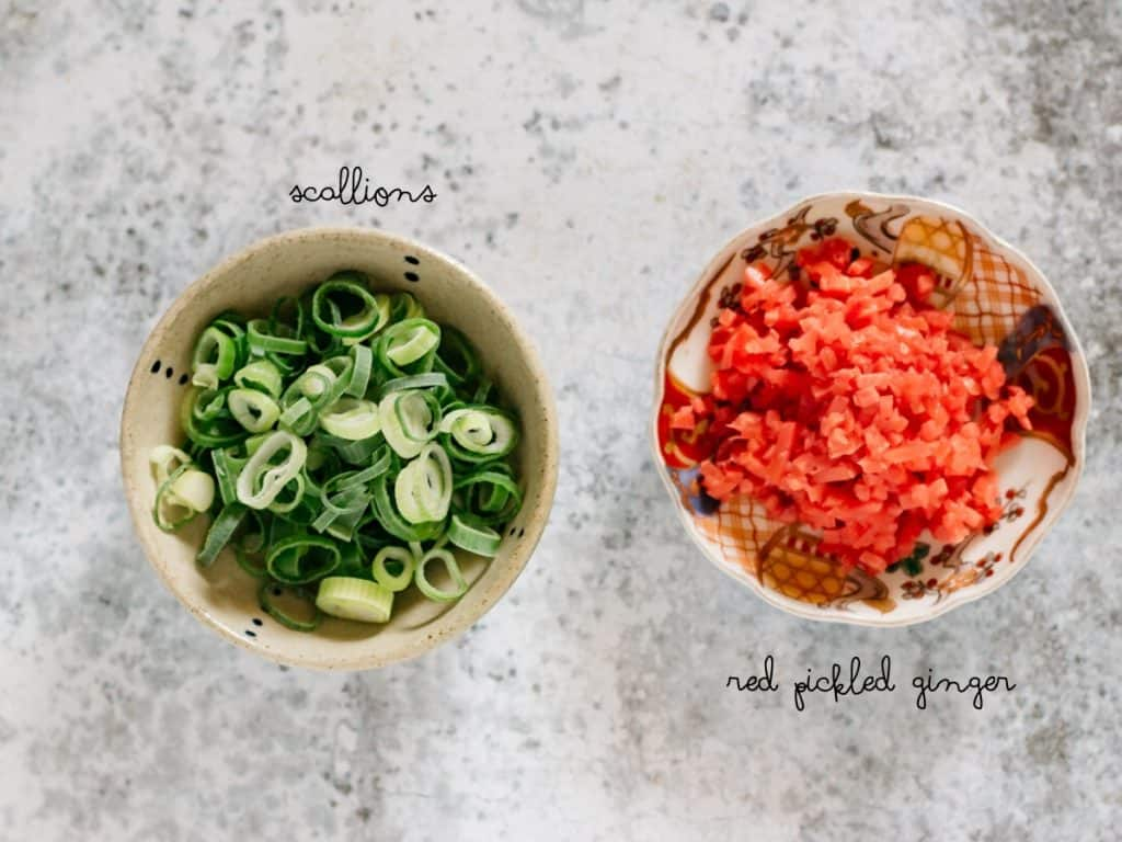 chopped scallions and chopped red pickled ginger in bowls