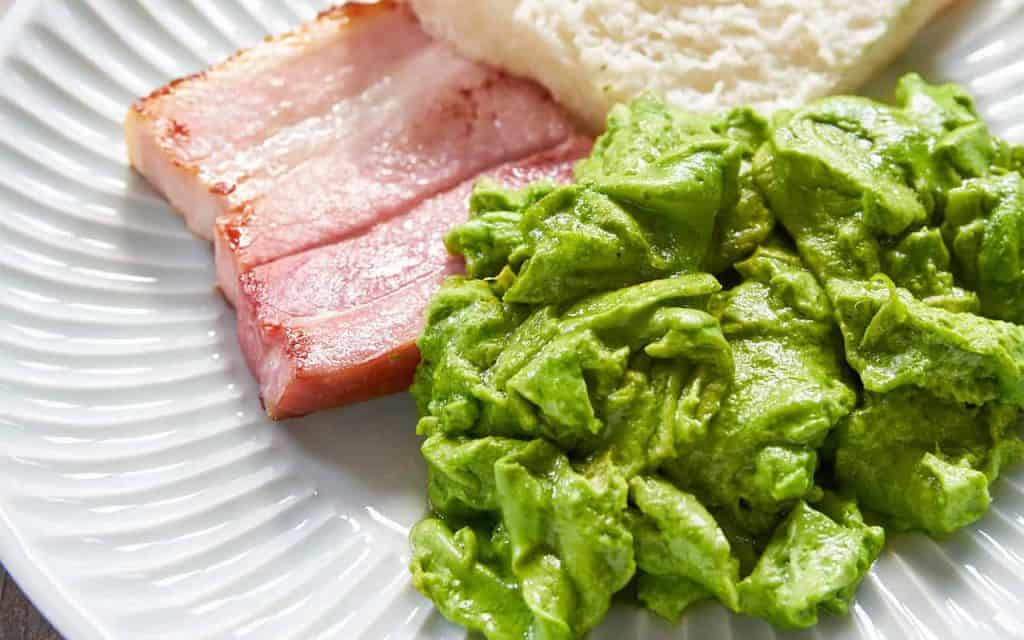 scrambled egg coloured with matcha green with cooked ham and a piece of bread