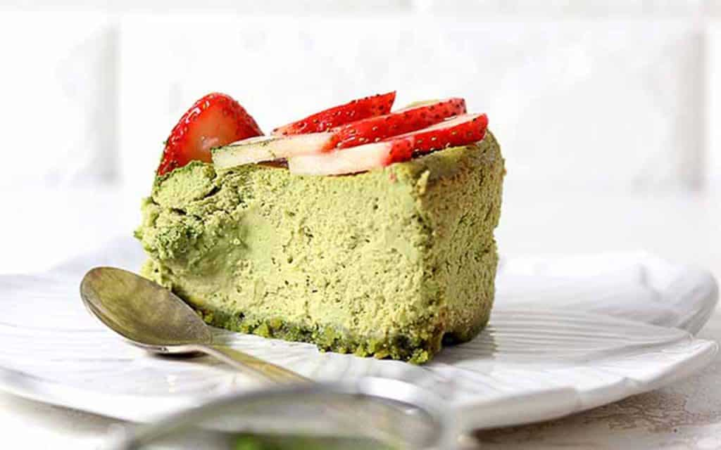 Keto low carb Japanese matcha cheesecake piece  with a spoon