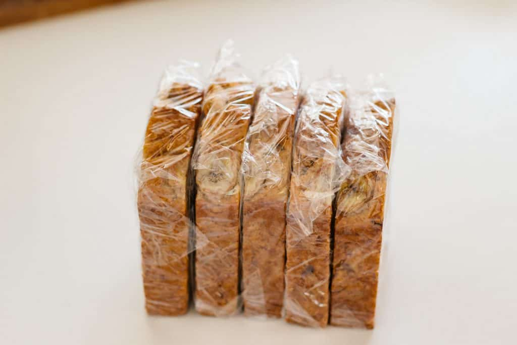 5 sliced banana bread  wrapped individually with cling wrap