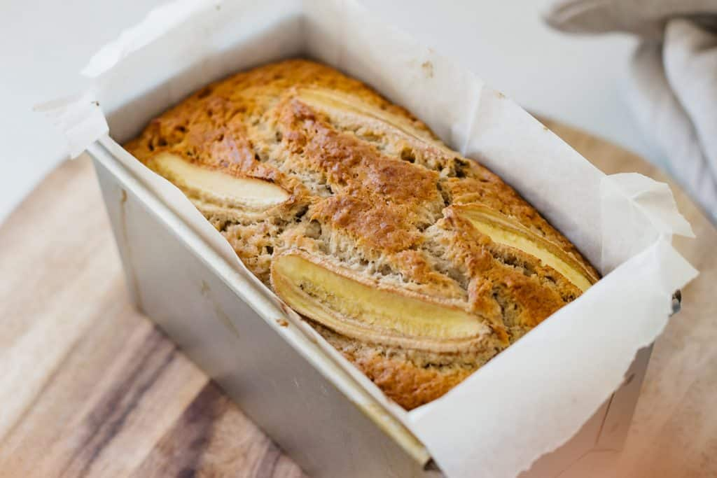 a loaf of bread banana freshly baked and still in baking foam.
