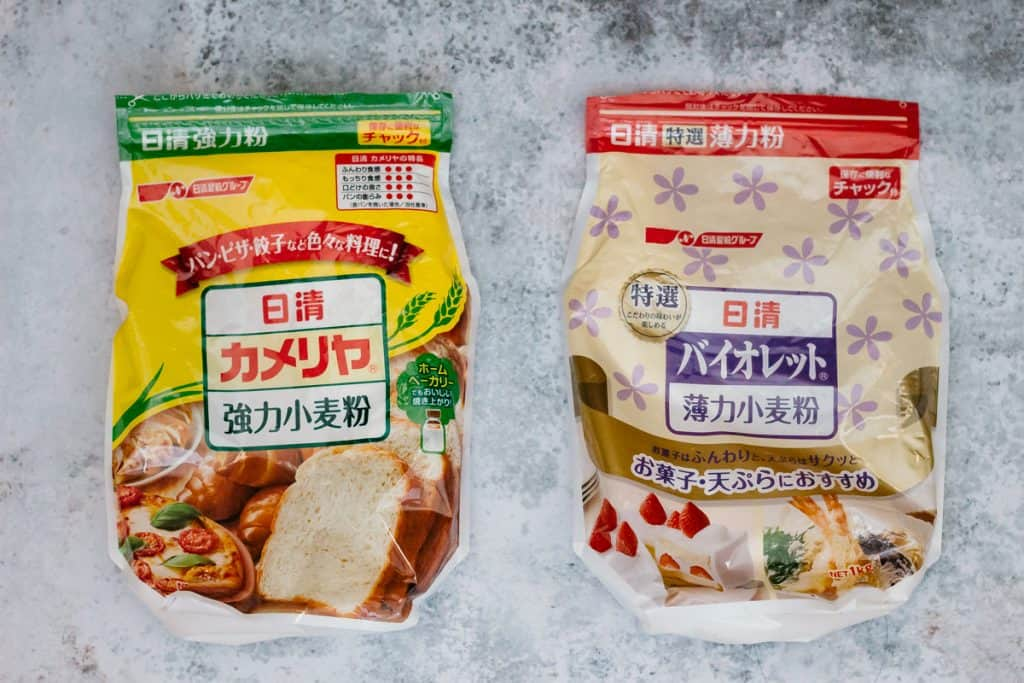 Bread flour package on the left and all purpose flour on the right