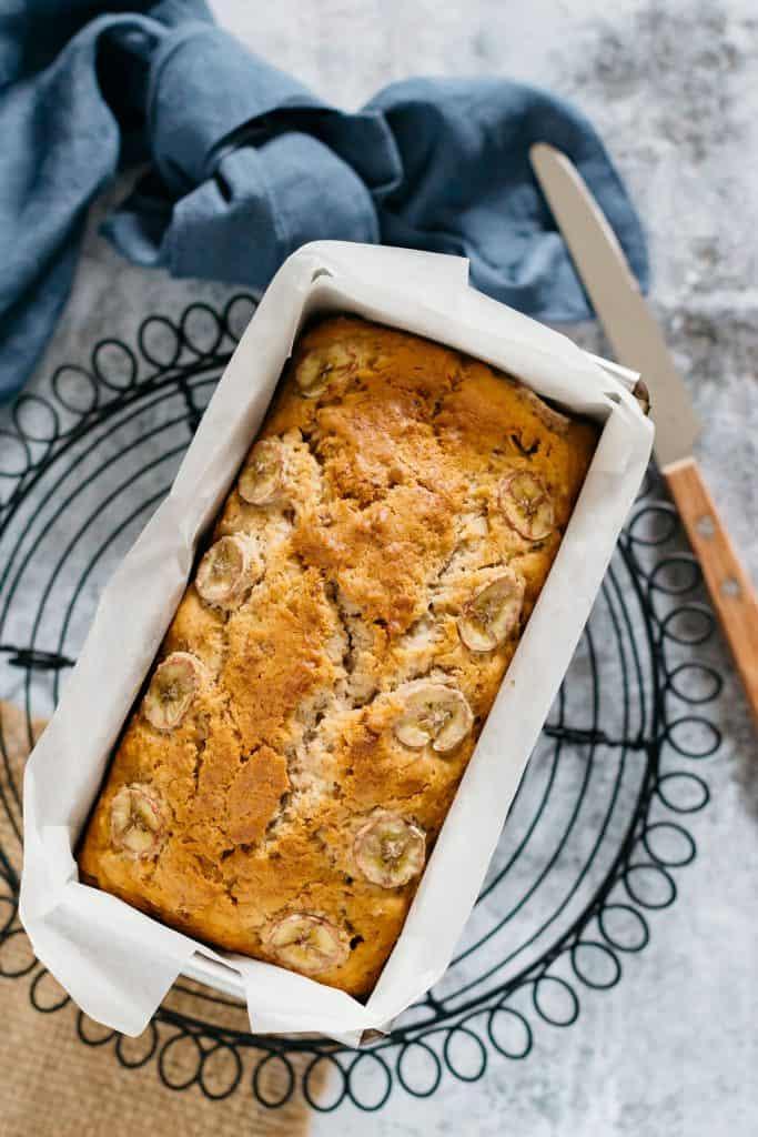 banana bread loaf in a bread baking foam