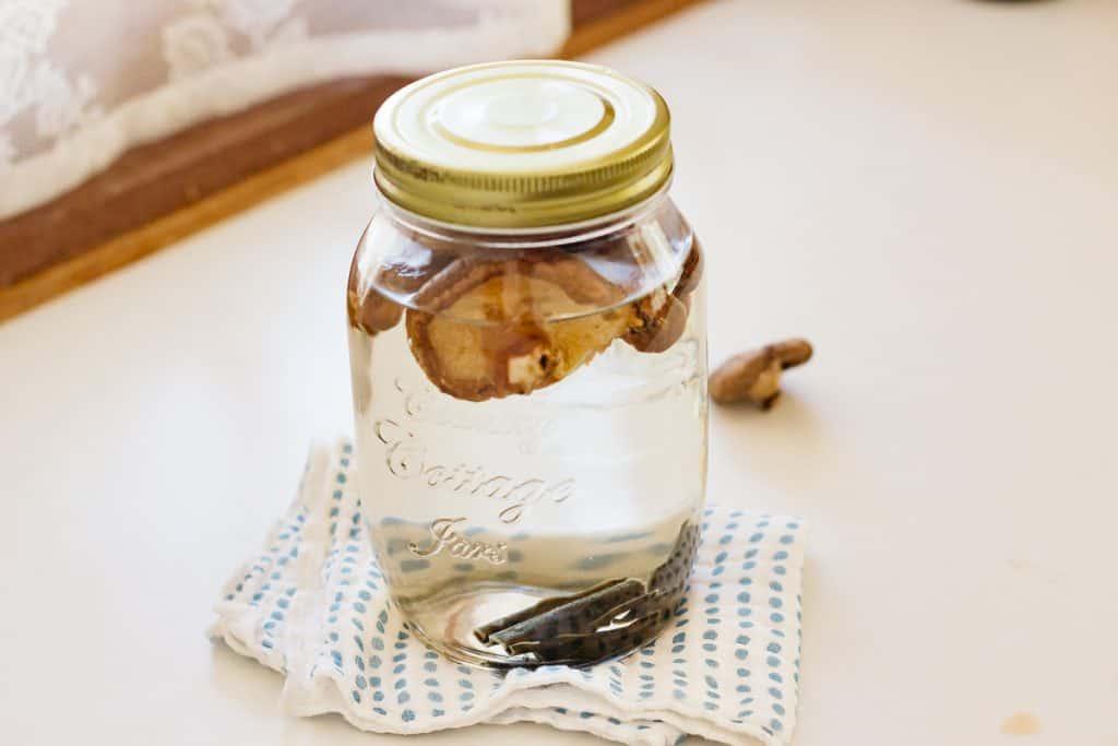 Dried shiitake mushrooms and dried kelp steeping in a jar of water