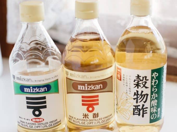 three different rice vinegar bottles
