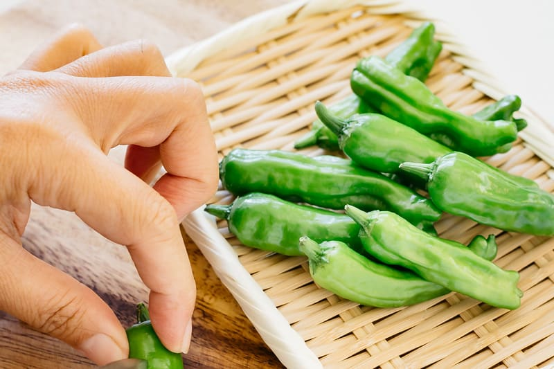 Shishito peppers on a bamboo tray