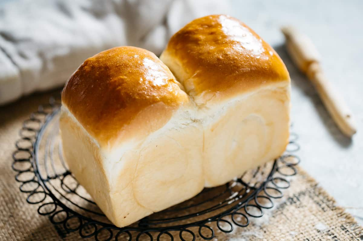 Freshly baked Shokupan Japanese milk bread on a cooling wire rack