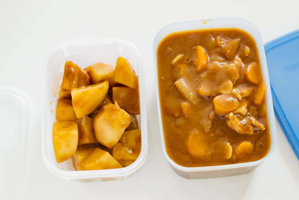 potato and curry in two separate containers for freezing